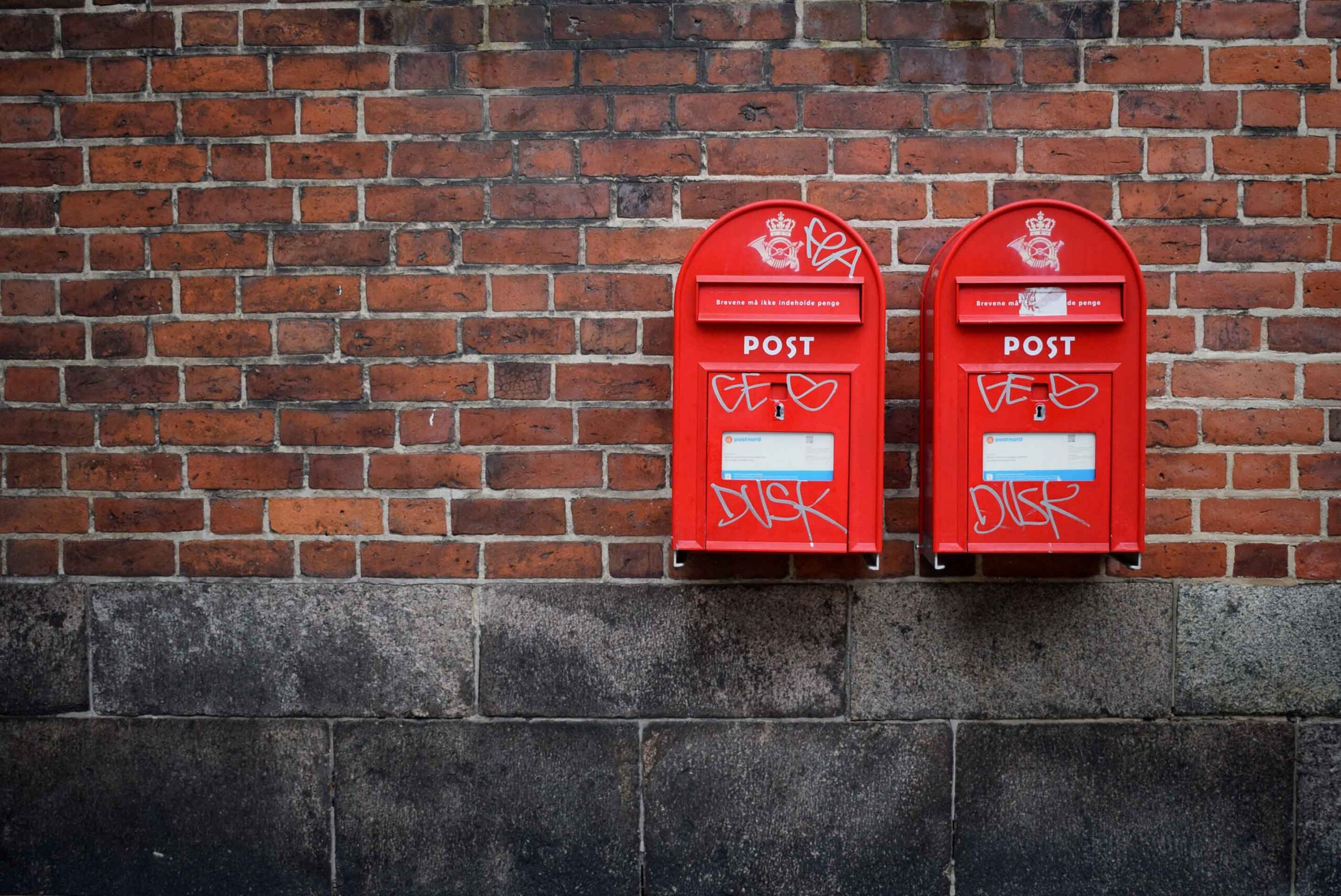 Mailboxes on a brick wall.